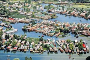 Srinagar: An aerial view of Dal Lake filled with deluxe houseboats, which is the main attraction of domestic and foreign tourists, in Srinagar on Tuesday. PTI Photo (PTI7_21_2015_000230A)