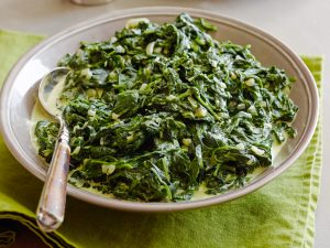 CREAMED SPINACH Tyler Florence Tyler's Ultimate/Ultimate Holiday Table Food Network Olive Oil, Unsalted Butter, Onion, Garlic, Baby Spinach, Heavy Cream, Nutmeg, Sea Salt, Pepper